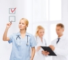healthcare, medical and technology - young doctor or nurse with